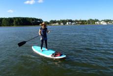 girl using stand up paddleboard va beach